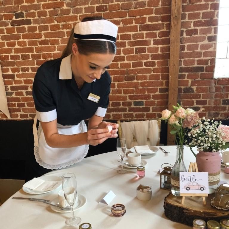 Waitress preparing afternoon tea for wedding